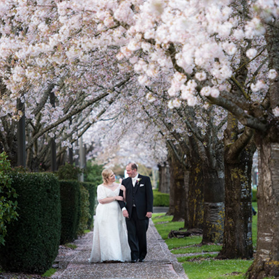 salem portland oregon wedding photography cherry blossoms bride groom walking